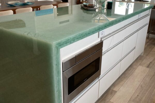 Coral Green Seaglass kitchen countertop with a waterfall