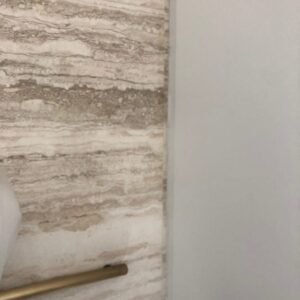 Italian Cristallo Travertine   Custom cut to book match throughout the home  We number all the slabs and do a dry layout at the Italian quarry  This quarry has a beautiful white vein and the quality of the Travertine is the best in the world of Travertines  We diamond Honed the floor after installation, for the perfect seamless satin finish